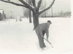 Hugh A. Howes shoveling snow in 1949